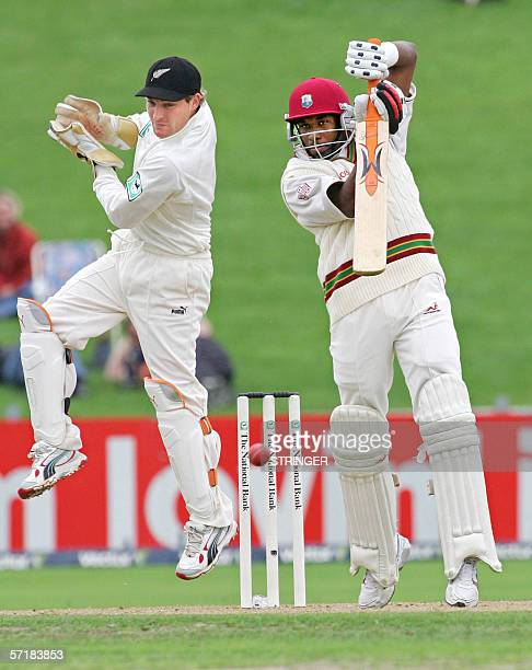 Dwayne Bravo of the West Indies plays a shot as wicket keeper Brendon McCullum of New Zealand reacts during day two of the 3rd test of the three test...
