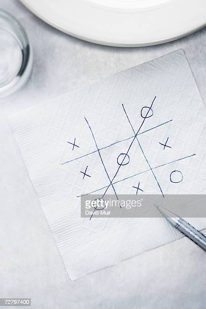 Napkin with tic tac toe game on table