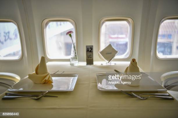 Napkins are folded on trays on a dining table inside of a Boeing 737 which is used for a restaurant at Guanggu Walking Street in Wuhan of Hubei...