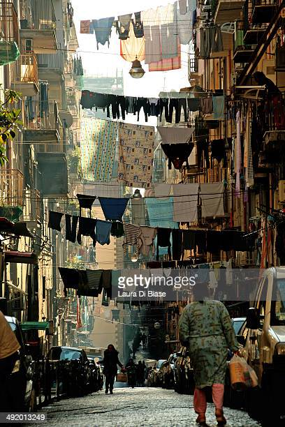 Naples alley with typical hanging laundry and people