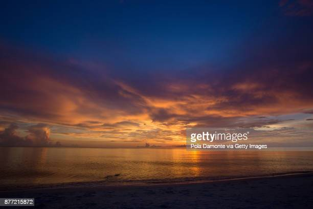 naples beach amazing sunset and calm ocean, florida, usa - dusk stock pictures, royalty-free photos & images