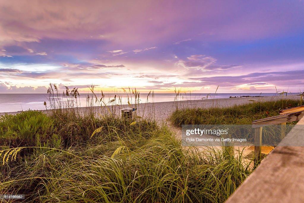 Naples beach shore and calm ocean, Florida : Stock Photo