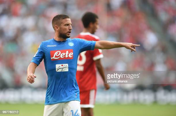 Naples' Dries Mertens gives instructions to his teammates during the Audi Cup soccer match between SSC Naples and Bayern Munich in the Allianz Arena...