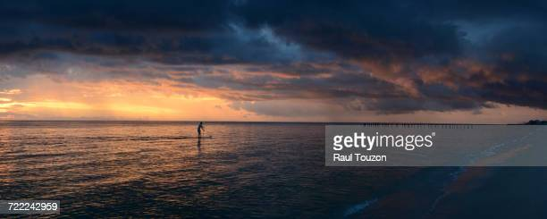 'Silhouette of a person paddleboarding off Tigertail Beach in Naples, Florida.'