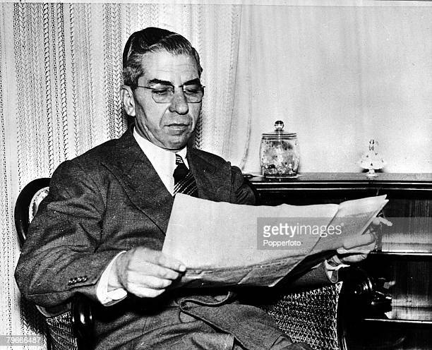 1955 Naples Italy American gangster Charles Lucky Luciano reads a newspaper Luciano was deported to Italy in 1946 where he lived in exile until his...