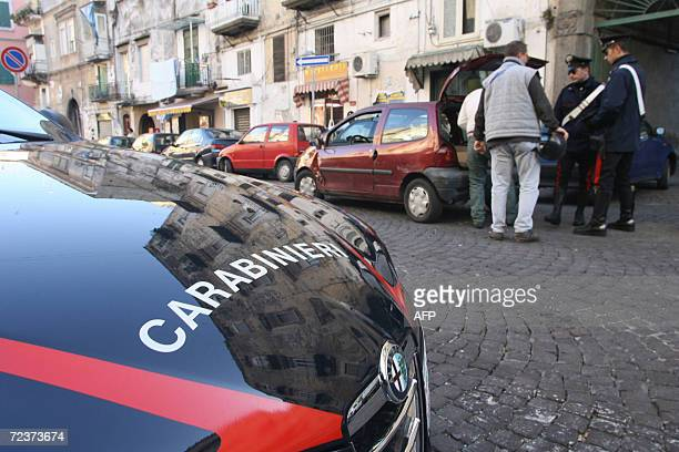 Italian Carabinieri check people in the street during a patrol in central Naples 03 November 2006Prime Minister Romano Prodi visited the city on...