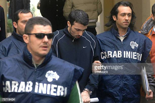 Vincenzo Di Lauro the boss of one of the Naples area's main mafia clans is escorted out of the Italian Carabinieri headquarters in Naples 27 March...