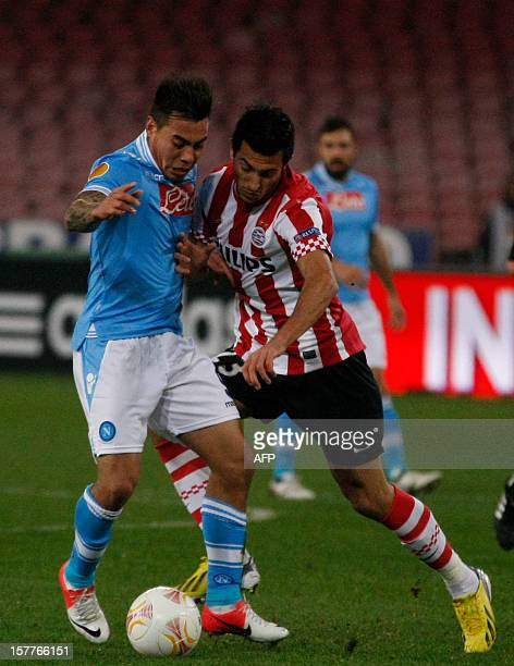 Napoli's Chilean forward Eduardo Vargas fights for the ball with PSV Bulgarian defender Stanislav Manolev during the UEFA Europa league Group F...