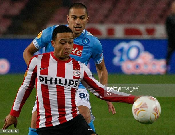 Napoli's Swiss midfielder Gokhan Inler fights for the ball with PSV Dutch forward Menphis Depay during the UEFA Europa league Group F football match...