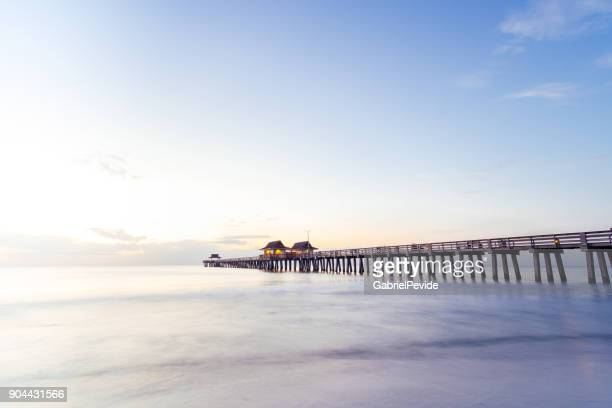 naples pier sunset - naples florida stock pictures, royalty-free photos & images