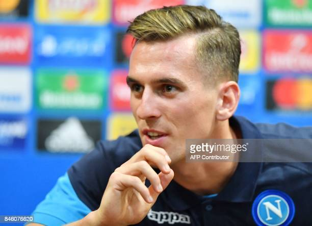 SSC Naples' Polish forward Arkadiusz Milik speaks during a press conference at the Metalist stadium in Kharkiv on September 12 on the eve of the UEFA...