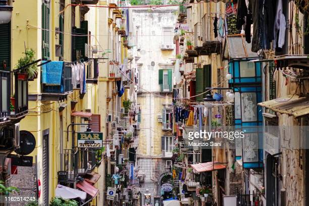 naples, quartieri spagnoli; low angle view of buildings and narrow street - naples italy stock pictures, royalty-free photos & images