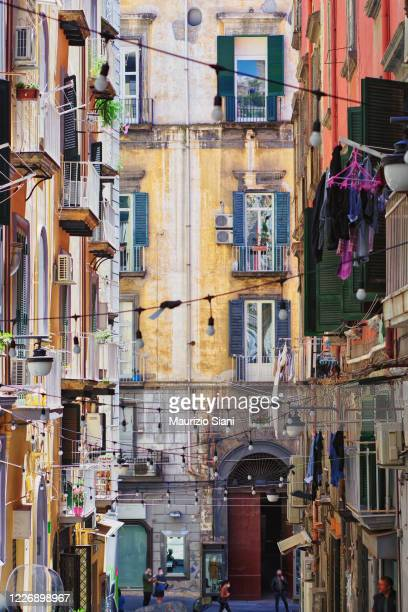 naples, quartieri spagnoli; low angle view of buildings and narrow street - napoli stock pictures, royalty-free photos & images