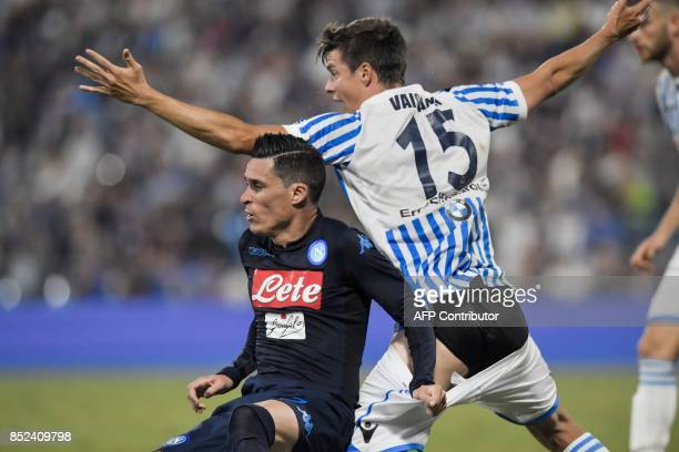 Naples' Spanish forward Jose Callejon pulls the shorts of Spal's Finnish defender Sauli Vaisanen during the Serie A football match between Spal and...
