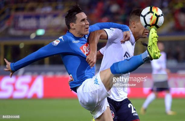 Naples' spanish forward Jose Callejon vies with Bologna's Italian defender Adam Masina during the Italian Serie A football match Bologna vs Napoli at...