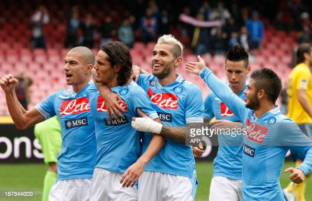 Naples' Uruguayan forward Edinson Cavani celebrates with teammates after scoring a goal during the Serie A football match between SSC Napoli and...
