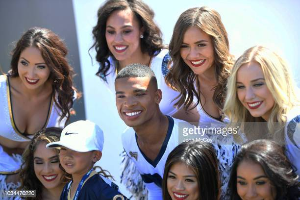 Napoleon Jinnes one of the first male NFL cheerleaders poses with his Los Angeles Rams Cheerleaders squad before the game against the Arizona...