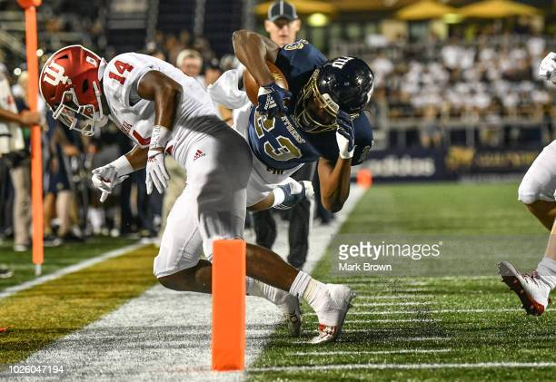 Napoleon Maxwell of the FIU Golden Panthers dives for the end zone during the second half against the Indiana Hoosiers at Ricardo Silva Stadium on...