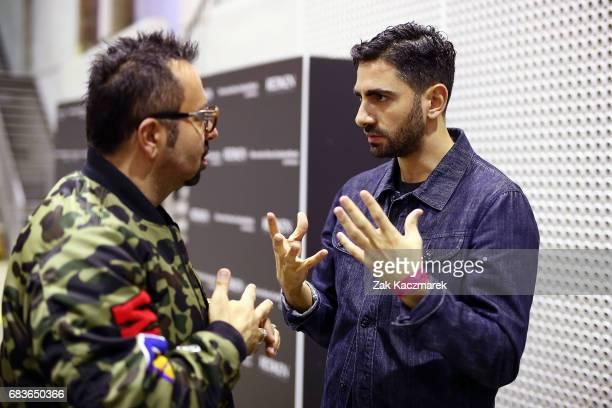 Napoleon Perdis and Christpoher Esber are seen talking backstage ahead of the Christopher Esber show at MercedesBenz Fashion Week Resort 18...