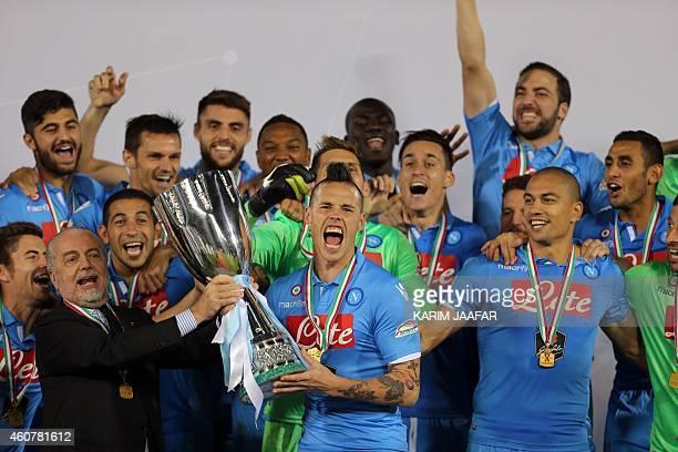 Napoli Chairman Aurelio De Laurentiis holds with Napoli's Slovak midfielder and captain Marek Hamsik the Italian Super Cup trophy following their...