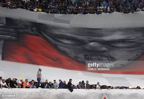 SSC Napoli fans deploy a banner showing a portrait of movie character Hannibal Lecter a cannibalistic serial killer during the UEFA Europa League...