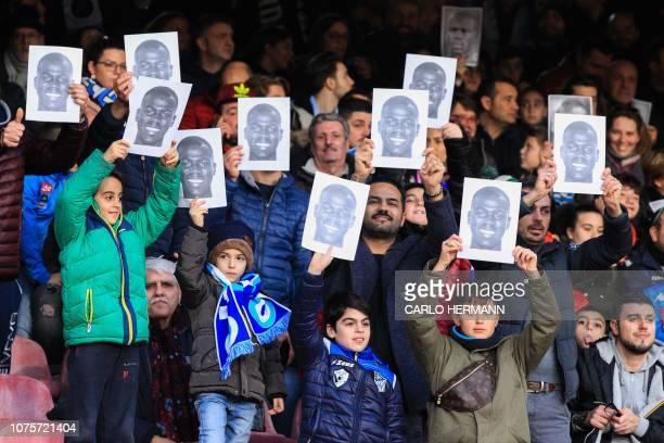 Napoli fans hold porraits of Napoli's Senegalese defender Kalidou Koulibaly prior to the Italian Serie A football match Napoli vs Bologna on December...