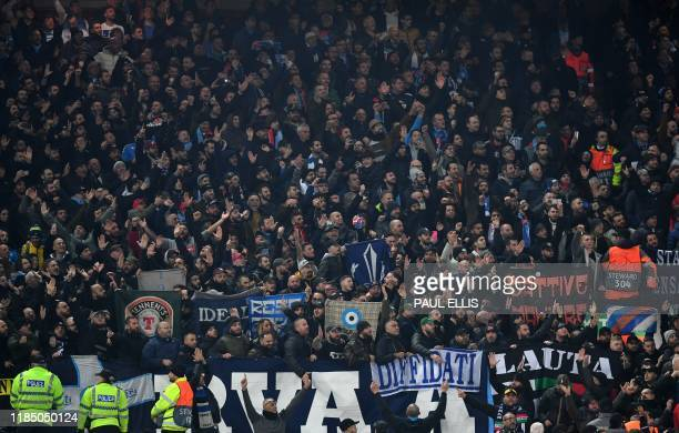 Napoli fans react during the UEFA Champions league Group E football match between Liverpool and Napoli at Anfield in Liverpool, north west England on...