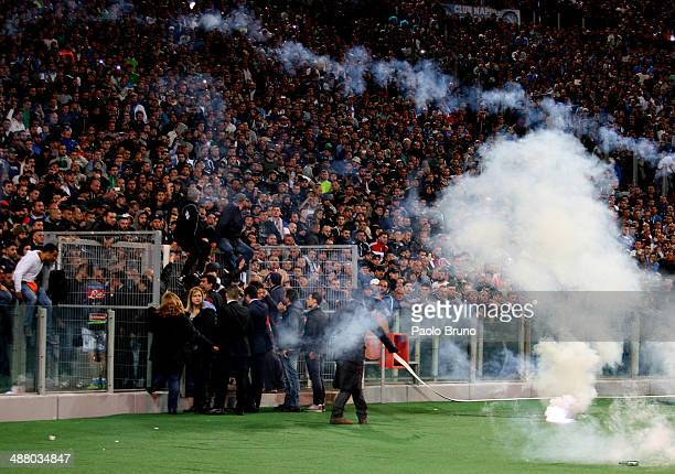 Napoli fans throw a flares before the TIM Cup final match between ACF Fiorentina and SSC Napoli at Olimpico Stadium on May 3, 2014 in Rome, Italy.
