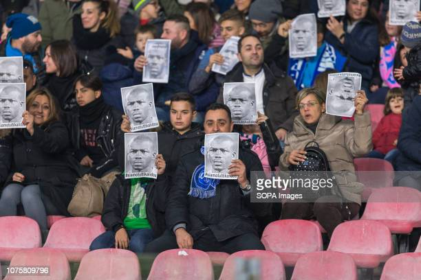 Napoli fans wear the mask of koulibaly to protest against racism during the Serie A football match between SSC Napoli and Bologna FC at San Paolo...