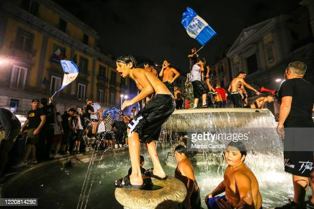 Napoli football fans celebrate the victory of the Italian Cup, won 4 to 2 against Juventus, with a dip in the Artichoke fountain in Plebiscito square.