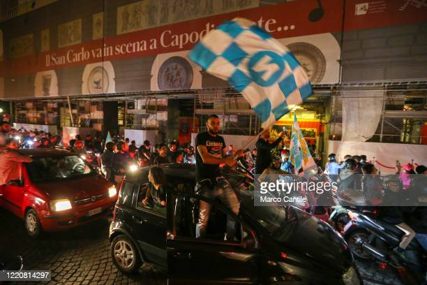 Napoli football fans celebrate the victory of the Italian Cup, won 4 to 2 against Juventus, in a street of Naples on a car.