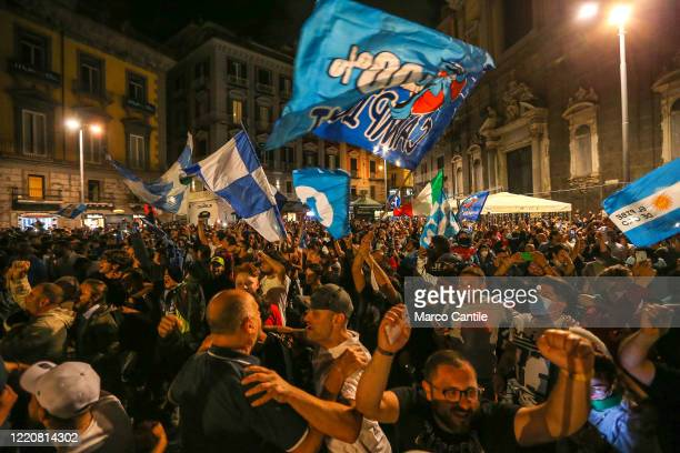 Napoli football fans celebrate the victory of the Italian Cup, won 4 to 2 against Juventus, in Plebiscito square.