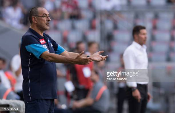 Napoli head coach Maurizio Sarri and Madrid's Diego Simeone follow the game from the sidelines during the Audi Cup semifinal match pitting Atletico...
