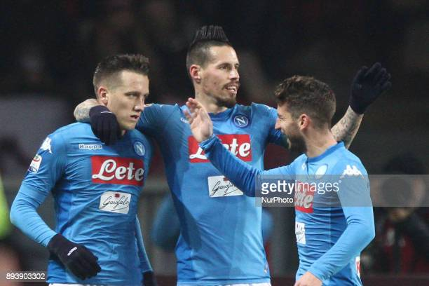 Napoli midfielder Piotr Zielinski celebrates with Napoli midfielder Marek Hamsik and Napoli forward Dries Mertens after scoring his goal during the...