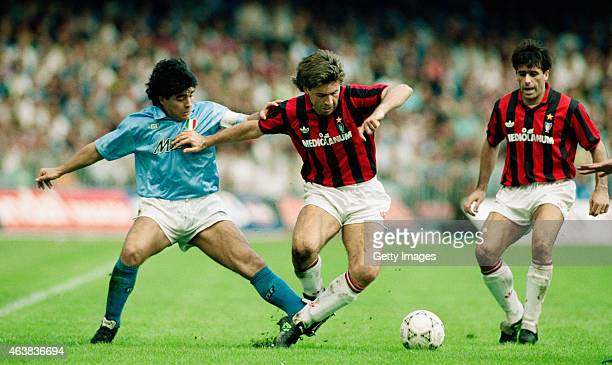 Napoli player Diego Maradona challenges Carlo Ancelotti of AC Milan during an Italian League match on October 21, 1990 in Naples, Italy.