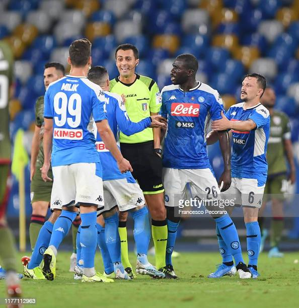 Napoli players arguing with referee Marco Di Bello after the red card to Kalidou Koulibaly of SSC Napoli during the Serie A match between SSC Napoli...