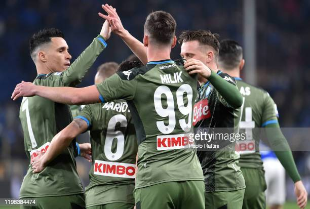 Napoli players celebrate after teammate Arkadiusz Milik scored their first goal during the Serie A match between UC Sampdoria and SSC Napoli at...