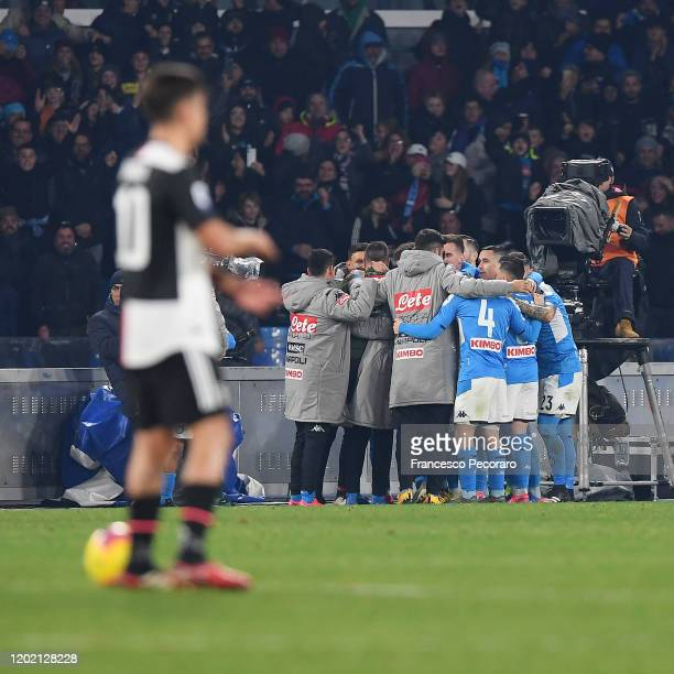 Napoli players celebrate the 10 goal scored by Piotr Zielinski beside the disappointment of Paulo Dybala of Juventus during the Serie A match between...