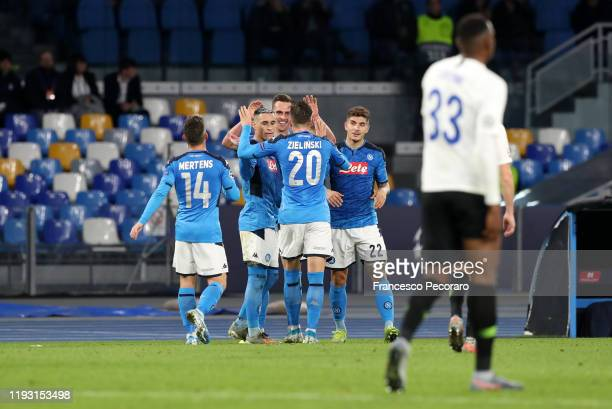 Napoli players celebrate the 30 goal scored by Arkadiusz Milik beside the disappointment of Jhon Lucumi of KRC Genk during the UEFA Champions League...