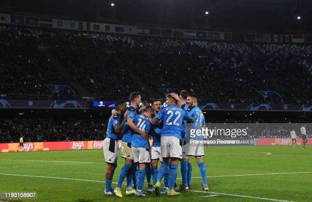 Napoli players celebrate the 40 goal scored by Dries Mertens during the UEFA Champions League group E match between SSC Napoli and KRC Genk at Stadio...