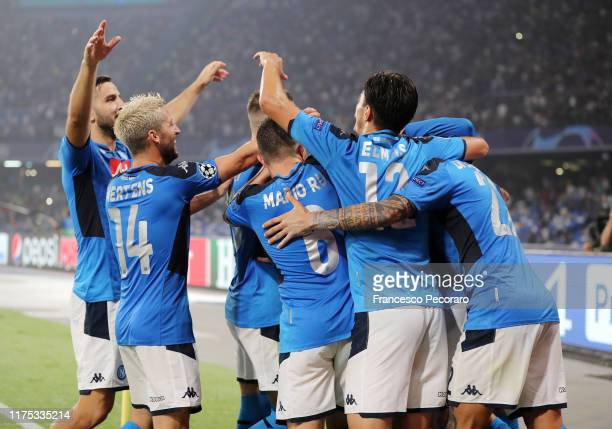 Napoli players celebrates the 20 goal scored by Fernando Llorente during the UEFA Champions League group E match between SSC Napoli and Liverpool FC...