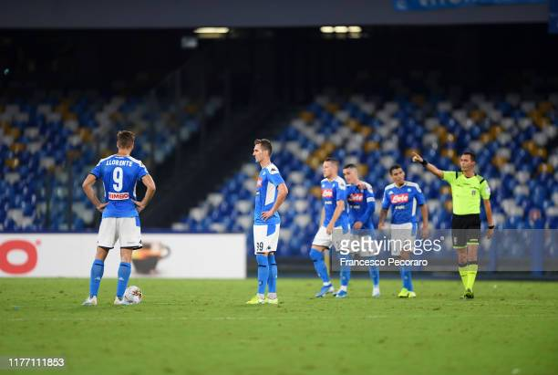 Napoli players stand disappointed after the Serie A match between SSC Napoli and Cagliari Calcio at Stadio San Paolo on September 25 2019 in Naples...
