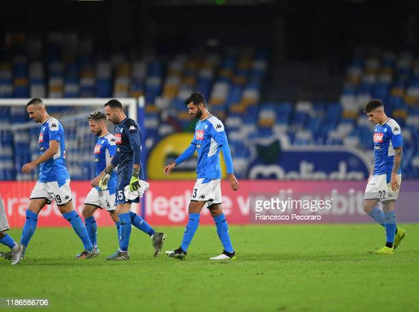 Napoli players stand disappointed after the Serie A match between SSC Napoli and Genoa CFC at Stadio San Paolo on November 09 2019 in Naples Italy