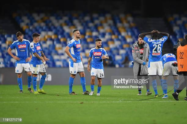 Napoli players stand disappointed after the Serie A match between SSC Napoli and Bologna FC at Stadio San Paolo on December 01 2019 in Naples Italy