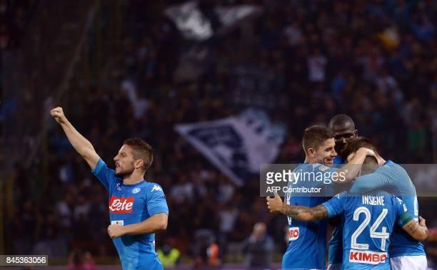 Napoli Spanish forward Jose Callejon celebrates with teammates after scoring during the Italian Serie A football match Bologna vs Napoli at the...