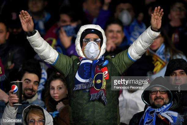 Napoli supporter with a mask due to Coronavirus before the UEFA Champions League round of 16 first leg match between SSC Napoli and FC Barcelona at...