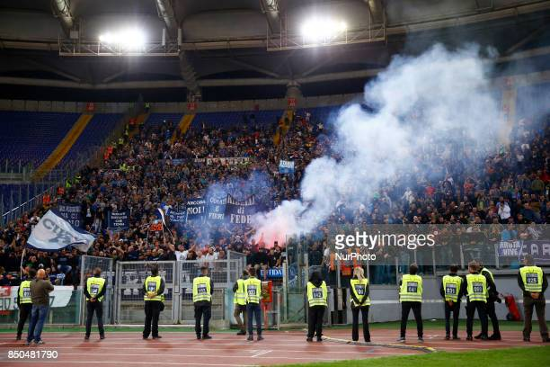 Napoli supporters celebrating after the goal scored by Jose Maria Callejon during the Serie A match between SS Lazio and SSC Napoli at Stadio...