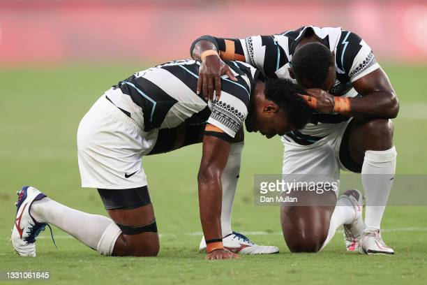 Napolioni Bolaca and Asaeli Tuivuaka of Team Fiji celebrate at the final whistle during the Rugby Sevens Men's Gold Medal match between New Zealand...