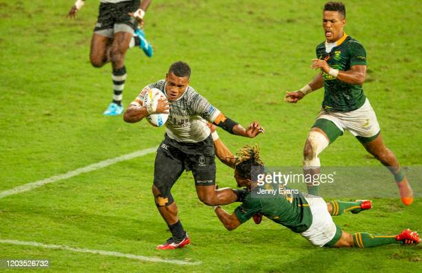 Napolioni Bolaca of Fiji breaks away to score a try during the 2020 Sydney Sevens finals match between Fiji and South Africa at Bankwest Stadium on...