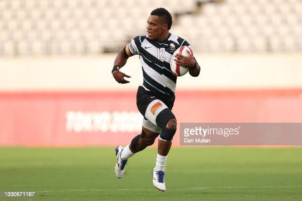 Napolioni Bolaca of Team Fiji makes a break to score a try during the Men's Pool B Rugby Sevens match between Fiji and Canada on day three of the...